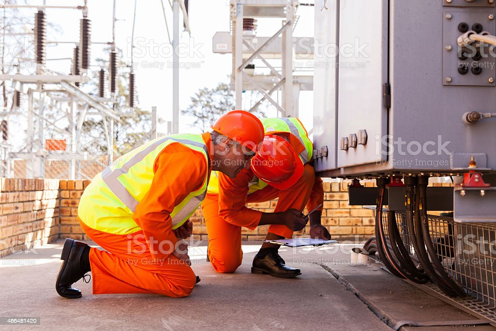 electrical engineers working in substation stock photo
