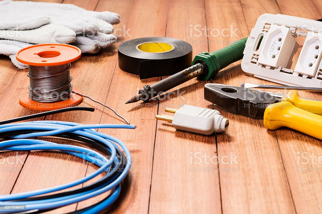 Electrical equipments, on a wooden surface. stock photo
