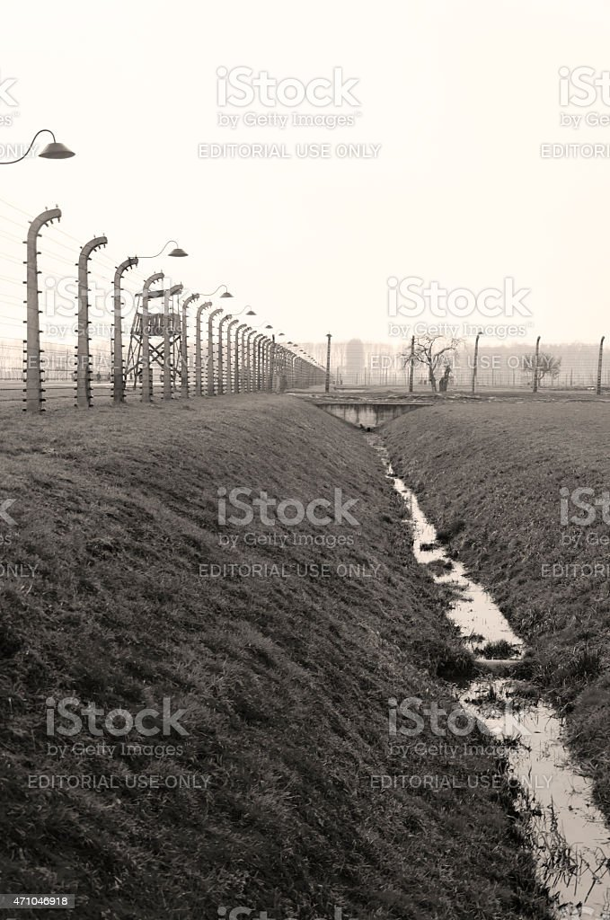 Electrical fence that surrounds the camp Auschwitz stock photo