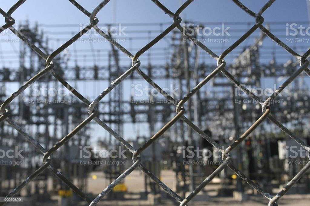 Electrical installation behind a fence stock photo