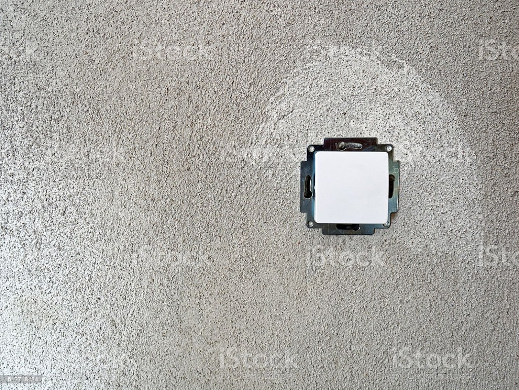electrical installation - Light switch in uncoated wall stock photo