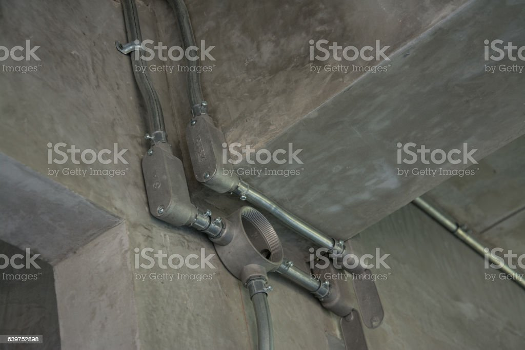 electrical junction box with galvanized conduit pipe connection stock photo