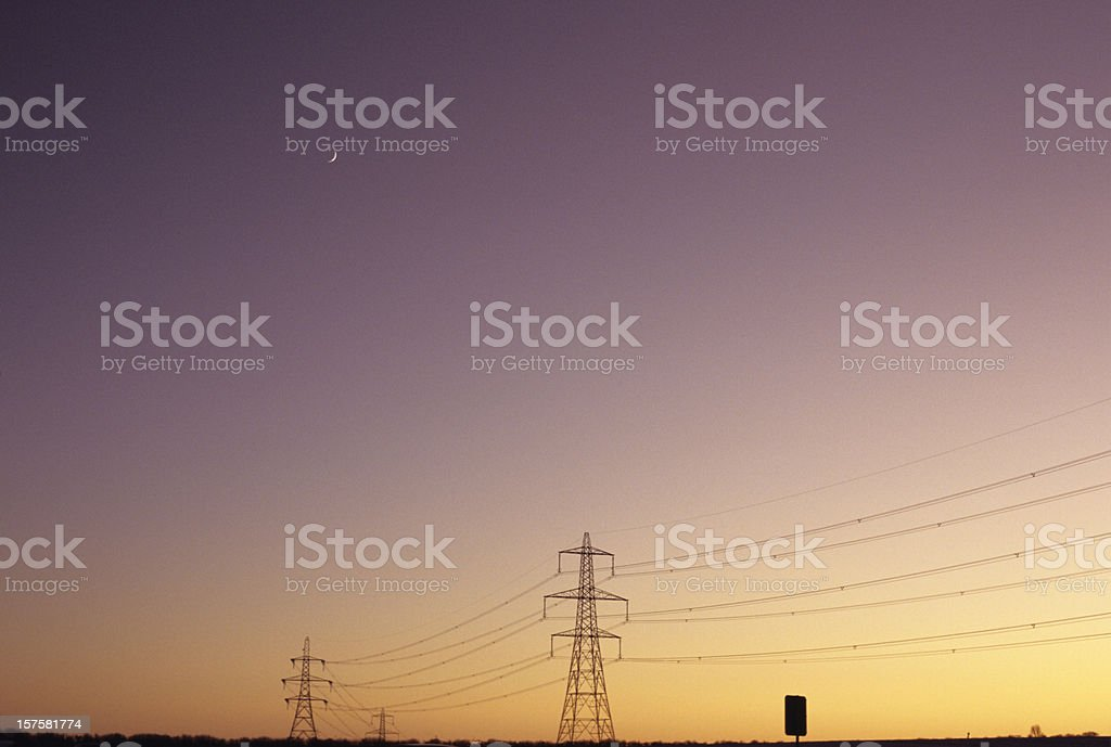 Electrical Moon - Electricity pylons in a sunset sky royalty-free stock photo