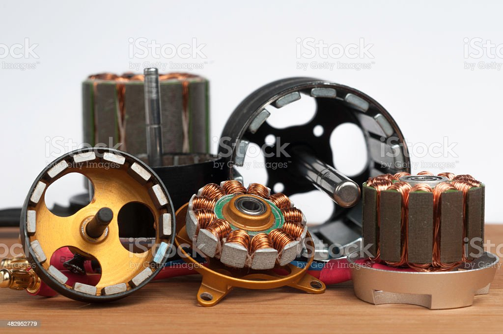 Electrical motors on wooden plate stock photo