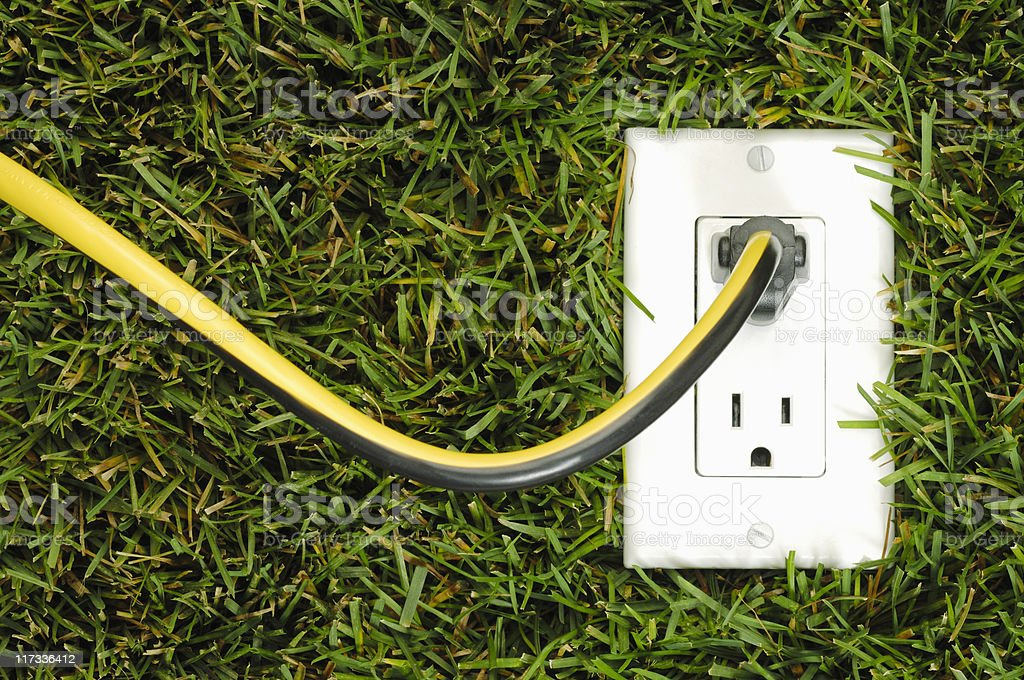Electrical outlet in grass, horizontal royalty-free stock photo