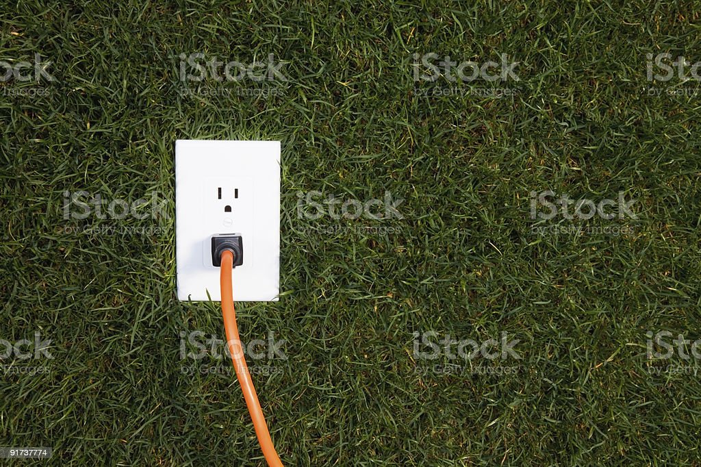 Electrical outlet in grass royalty-free stock photo