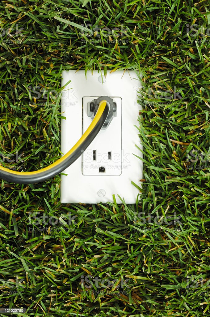 Electrical outlet in grass, vertical stock photo