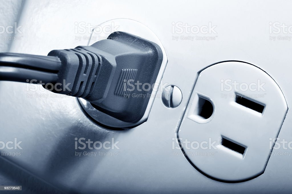 Electrical outlet with a black plug in one socket royalty-free stock photo