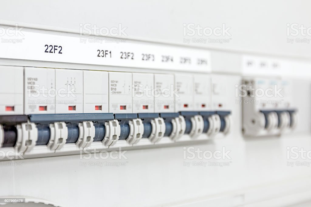 Electrical panel has automatic fuse switches, close up. stock photo