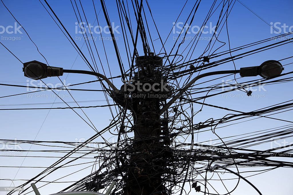 Electrical pole with a myriad electric cables stock photo