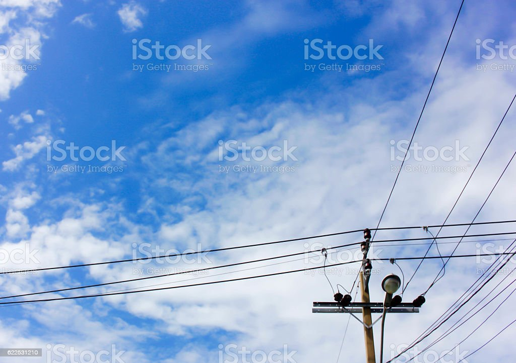 Electrical post and blue sky background stock photo
