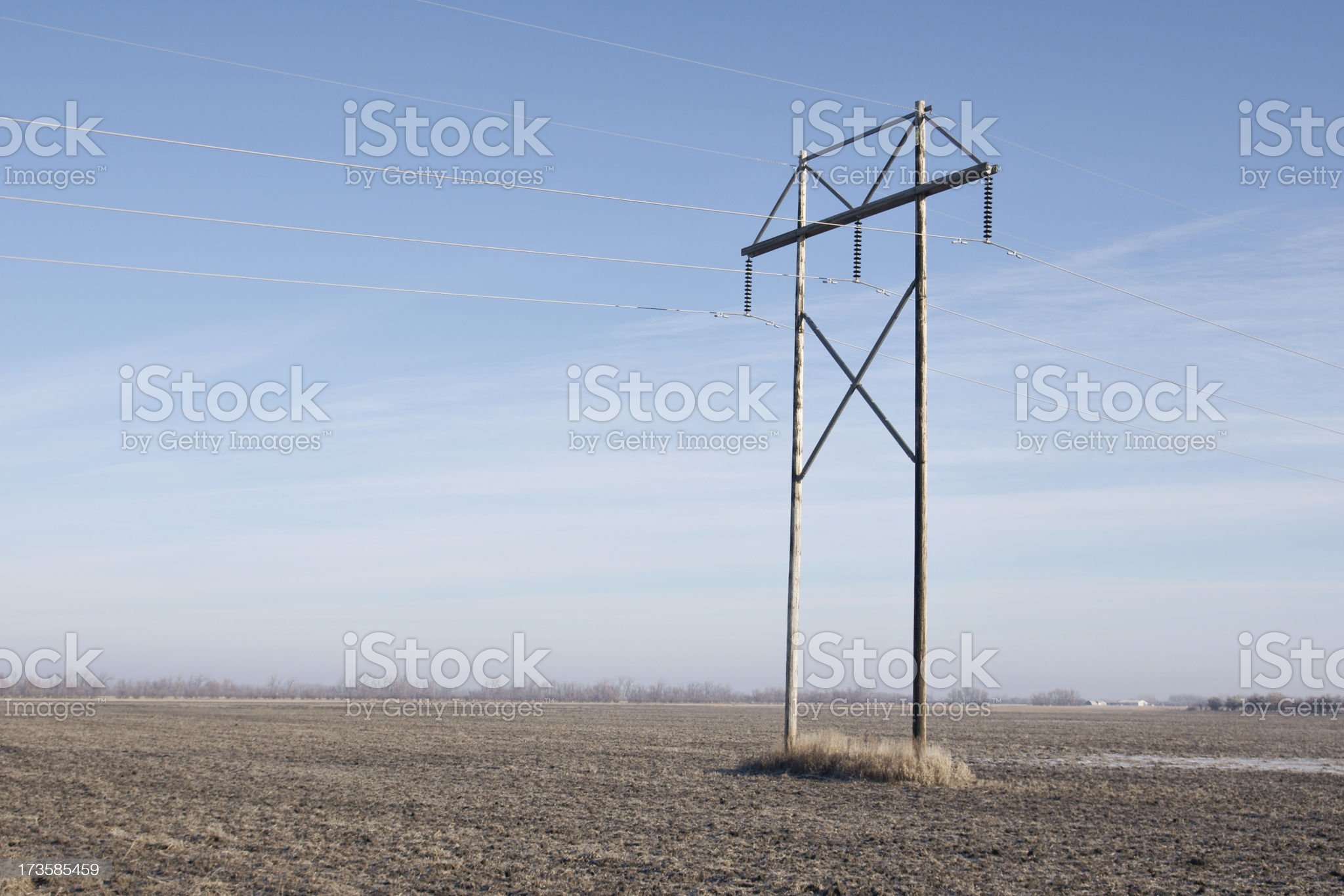 electrical power lines across field royalty-free stock photo