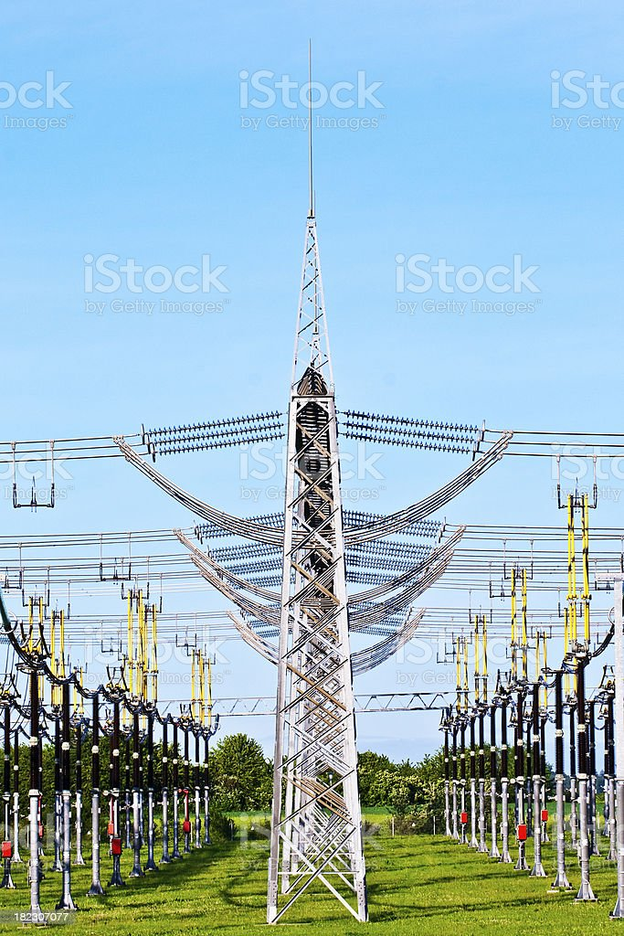 electrical power plant in beautiful colorful meadow royalty-free stock photo