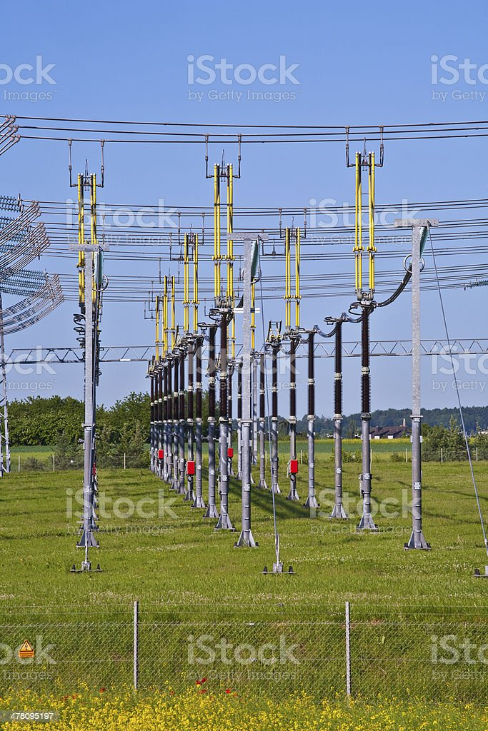 electrical power plant in  colorful meadow royalty-free stock photo