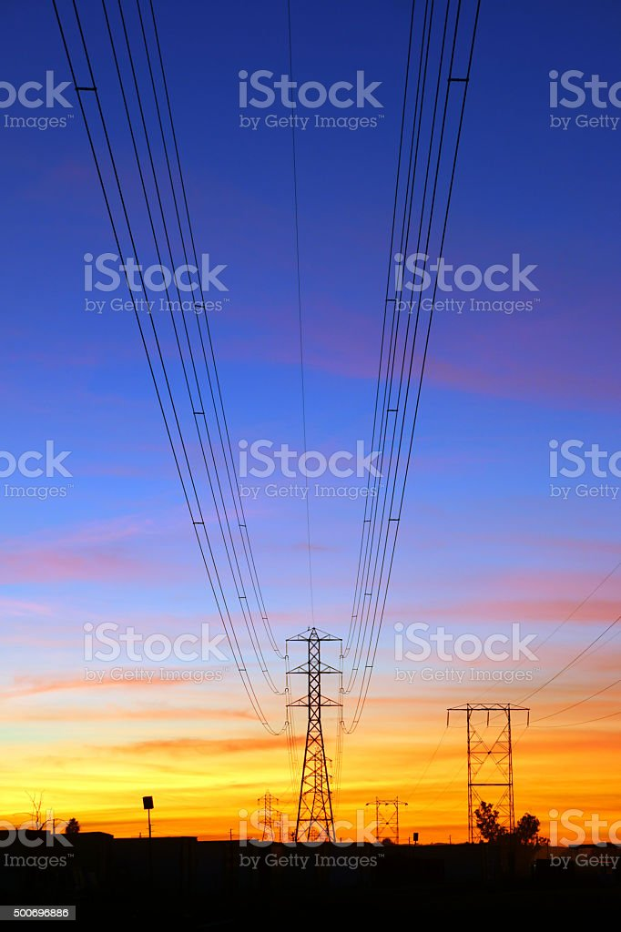 Electrical power wires and tower at sunset stock photo