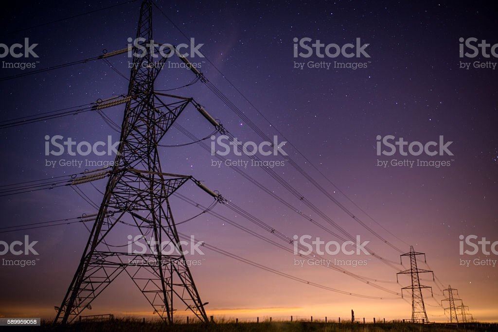 Electrical Pylons at Night stock photo