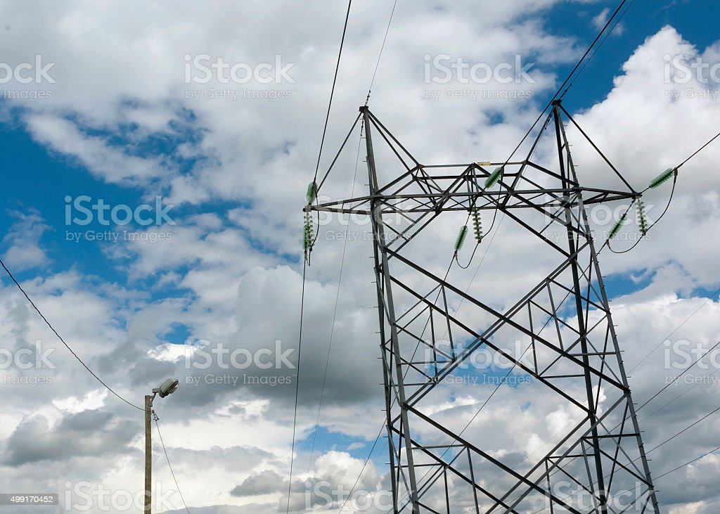 electrical pylons on cloudy sky stock photo
