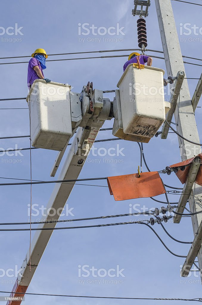 Electrical repairs on a power pole royalty-free stock photo
