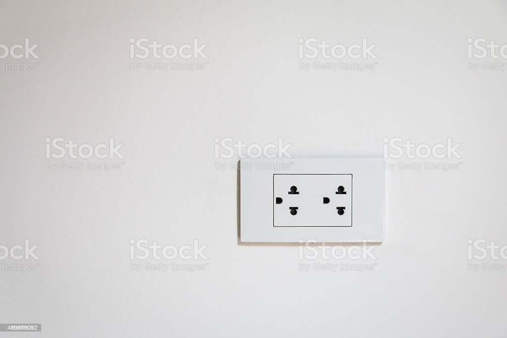 Electrical socket plug on  Wall stock photo