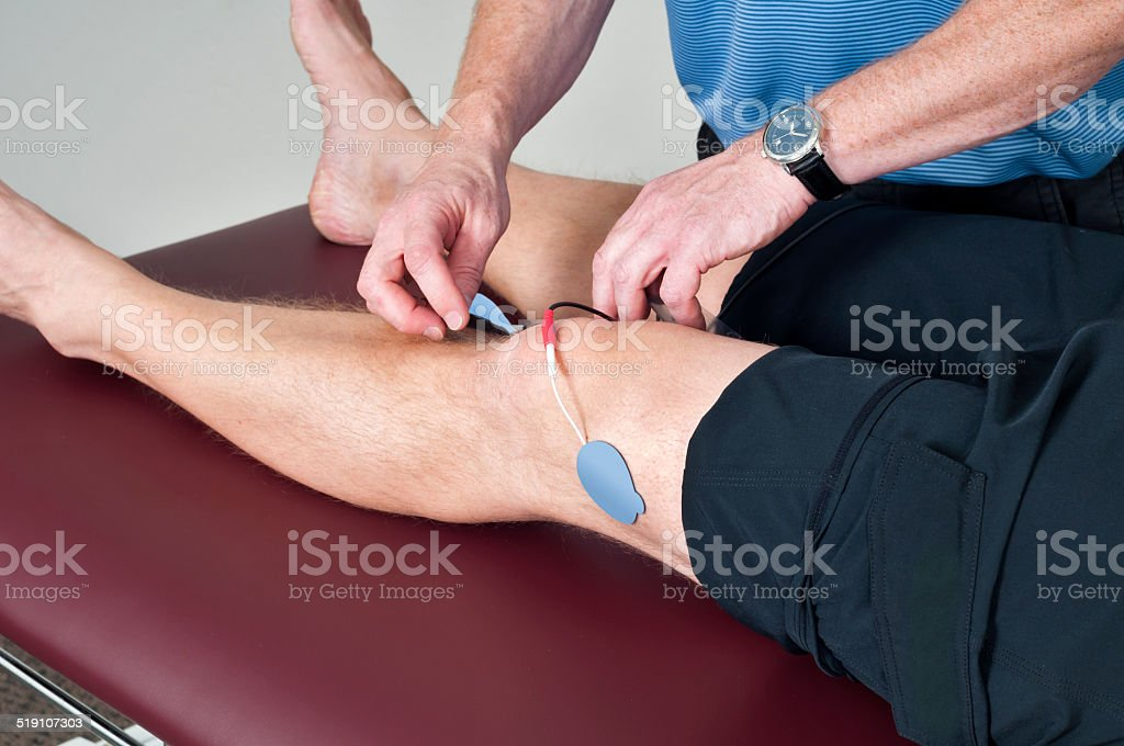 Electrical Stimulation on Knee - Physical Therapy stock photo
