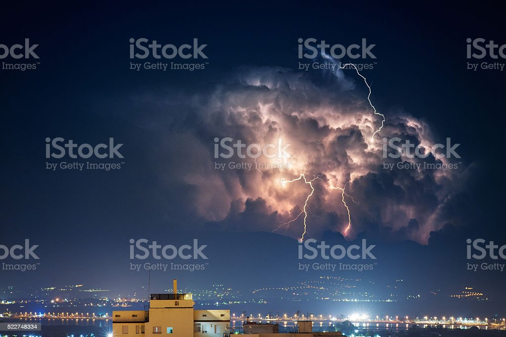 Electrical storm over the city by night stock photo