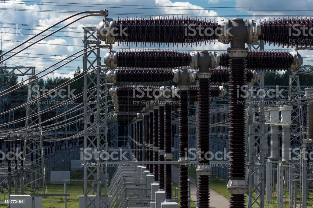 Electrical substation 330 kV, a series of high-voltage switches close-up. stock photo
