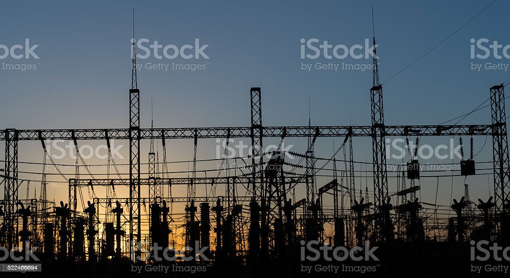 Electrical substation silhouette on the dramatic sunset background. stock photo