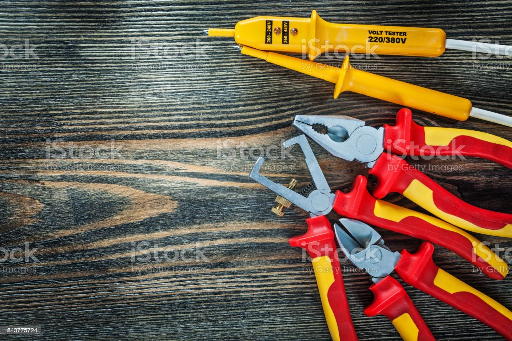 Electrical tester insulated wire strippers cutting nippers plier stock photo