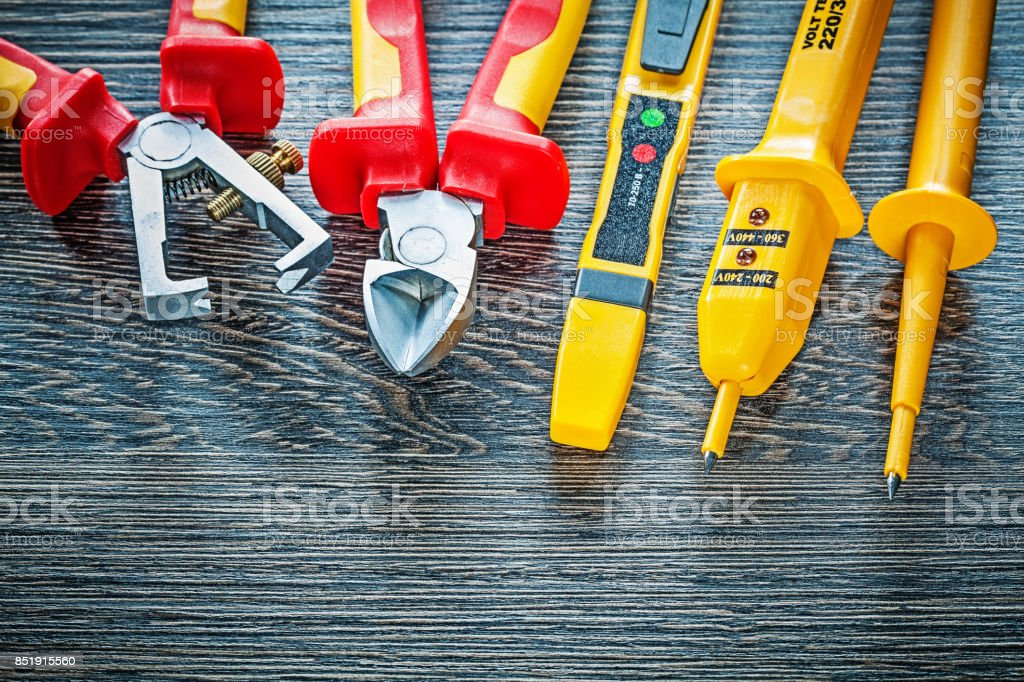 Electrical tester nippers insulation strippers on wooden board stock photo