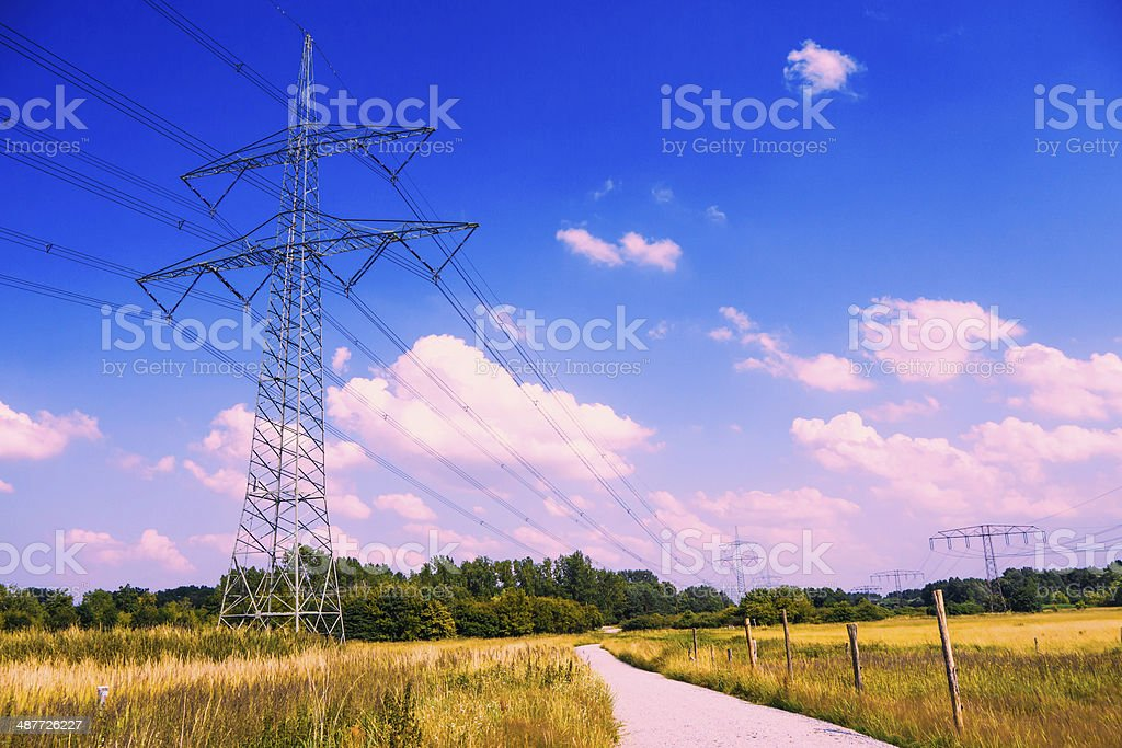 electrical tower in idyllic landscape stock photo