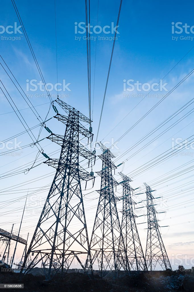 Electrical transmission tower  at sunset . stock photo