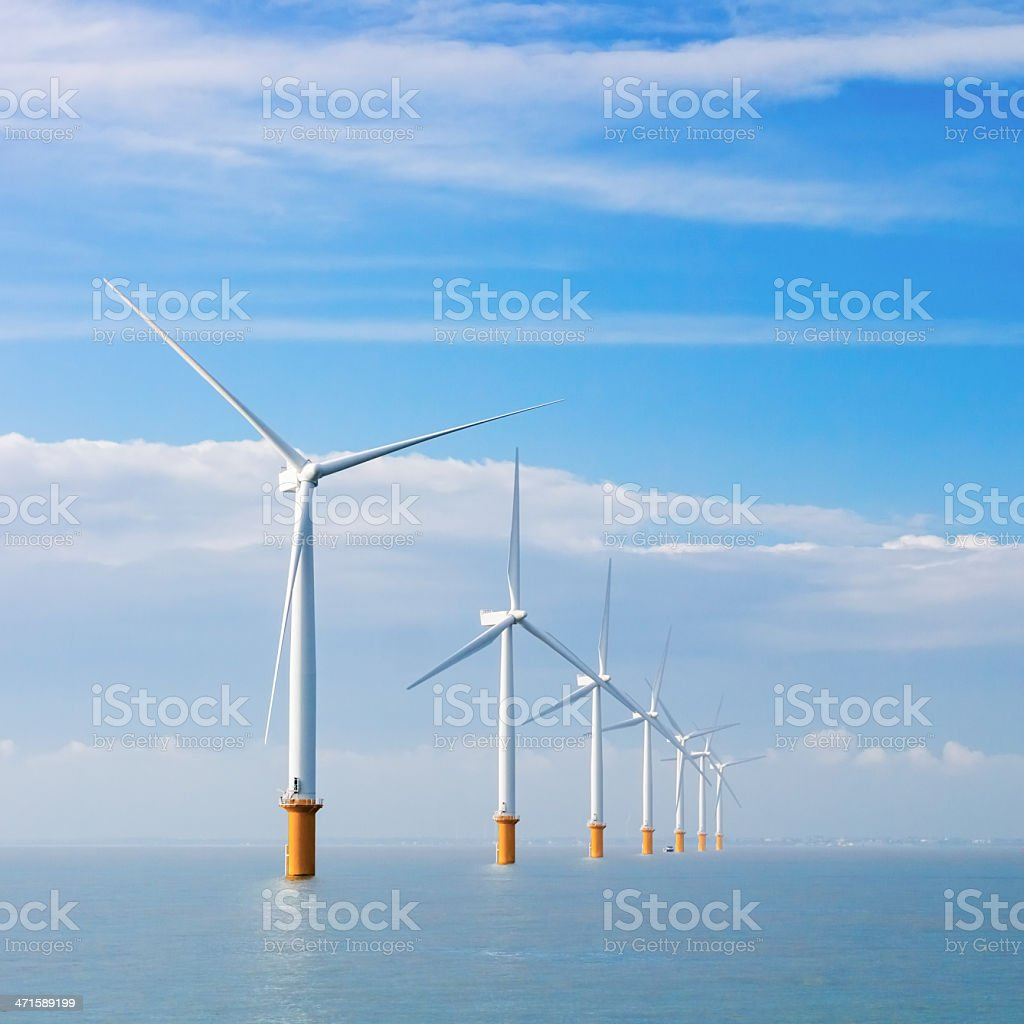 Electrical wind turbines at sea royalty-free stock photo