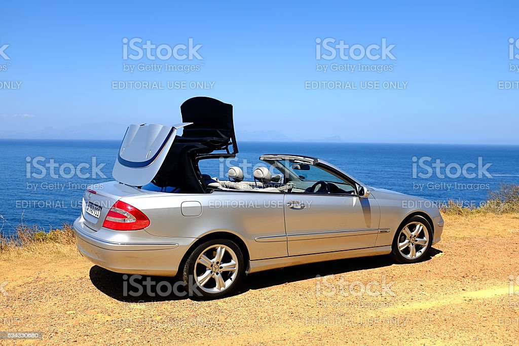 Electrically operated folding roof of 2005 Mercedes-Benz CLK500 opening stock photo