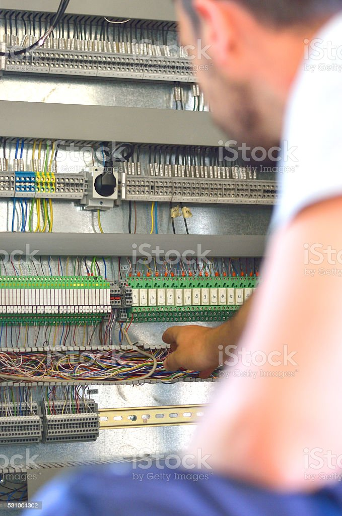 Electrician at Work in Electric Room stock photo