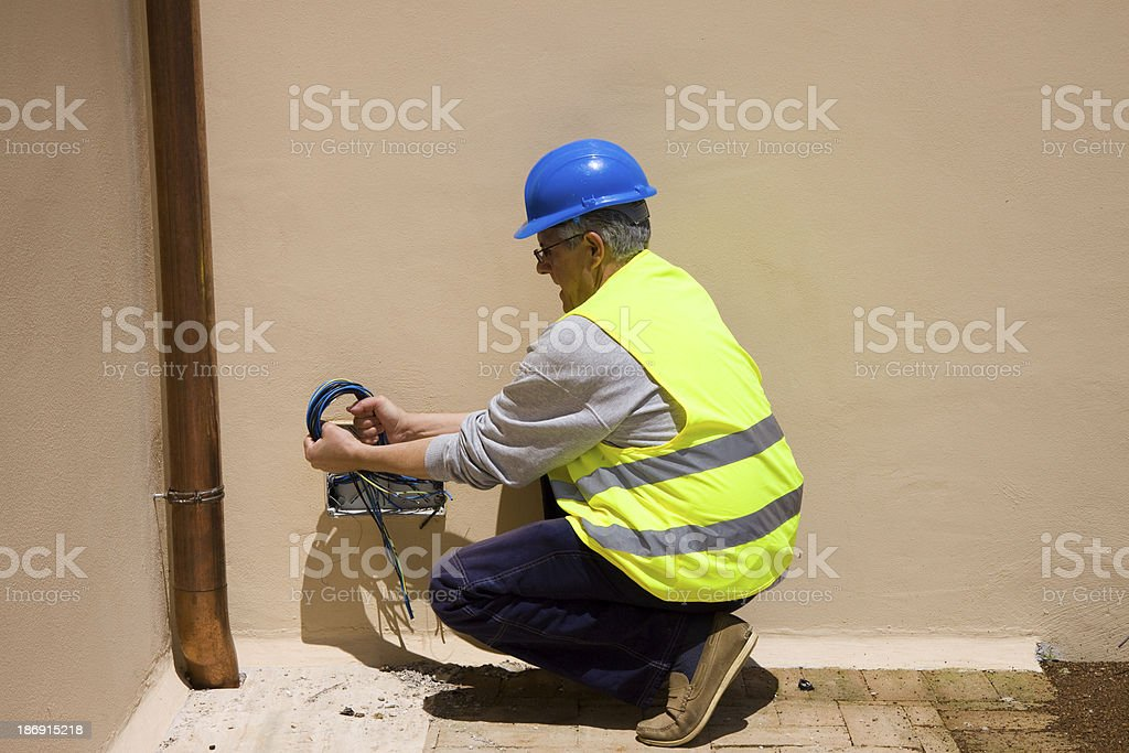 electrician at work royalty-free stock photo