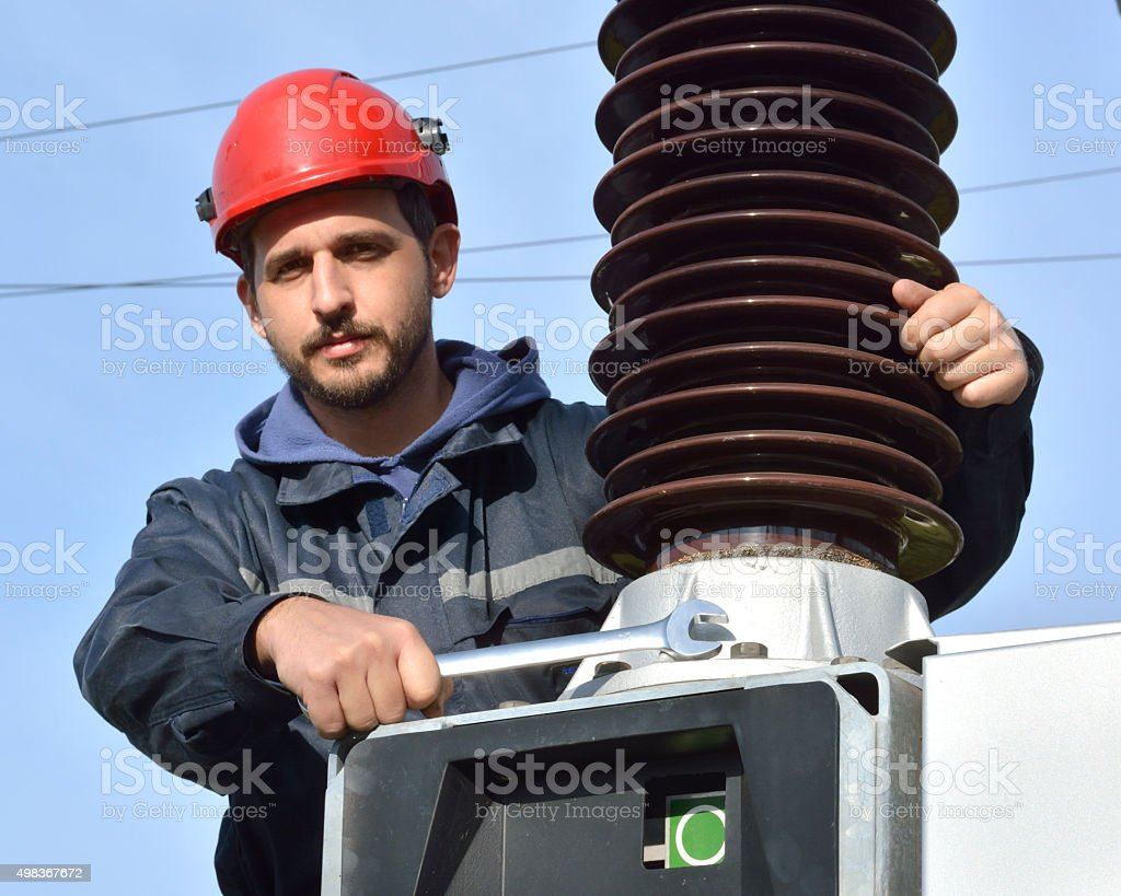 Electrician at Work With a Wrench stock photo