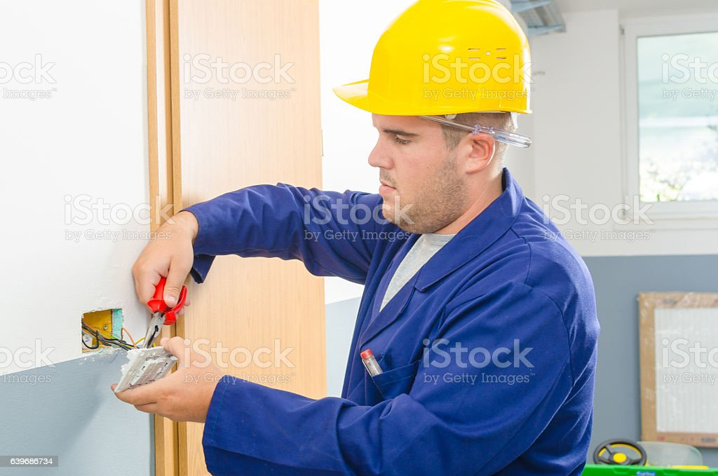 Electrician changed the switch stock photo