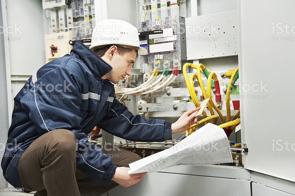 Electrician checking cabling power line stock photo