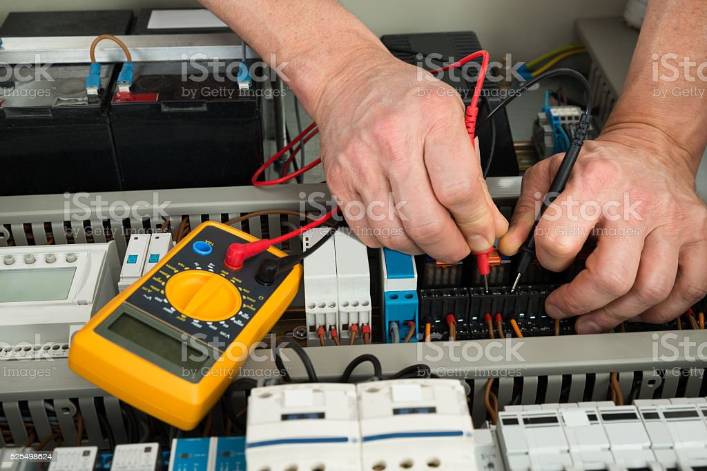 Electrician Checking Fuse stock photo