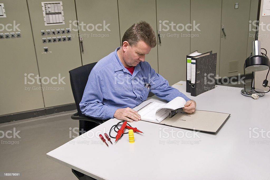 Electrician Checking the Circuit Layout royalty-free stock photo