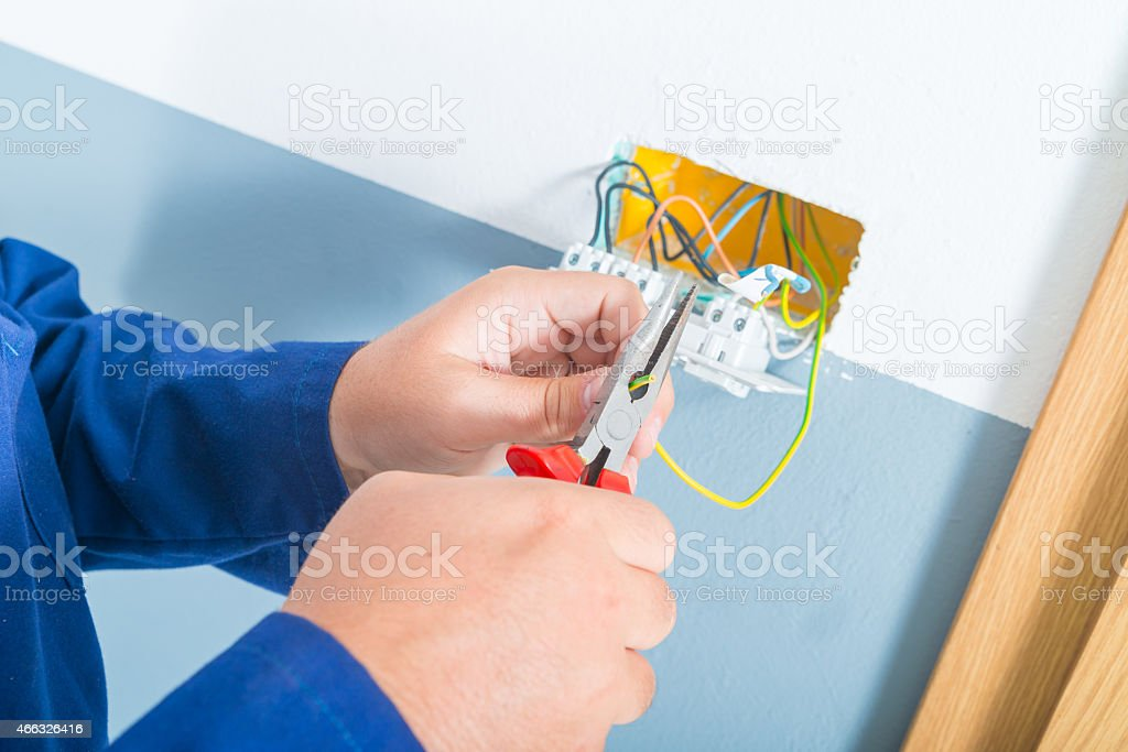 Electrician cutting cable stock photo
