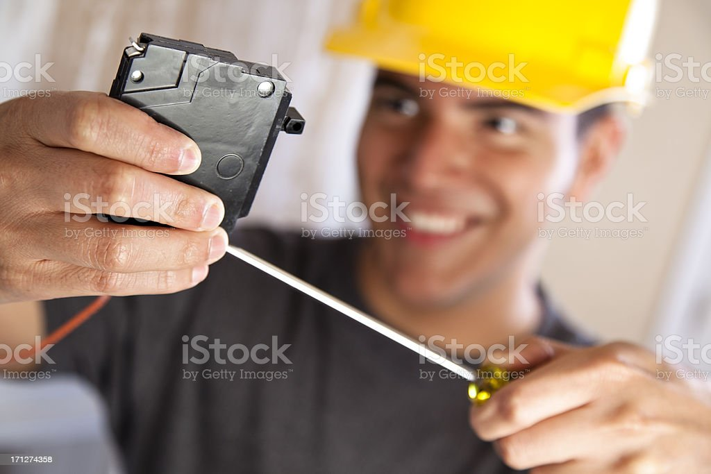 Electrician doing electrical work in circuit breaker box royalty-free stock photo