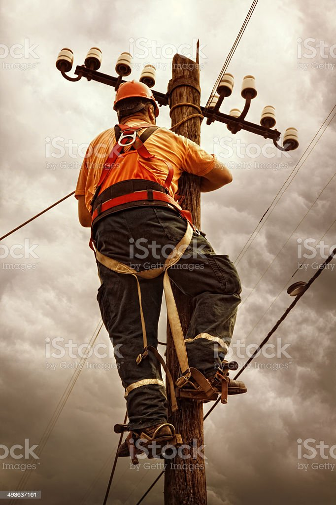 Electrician doing power line maintenance stock photo