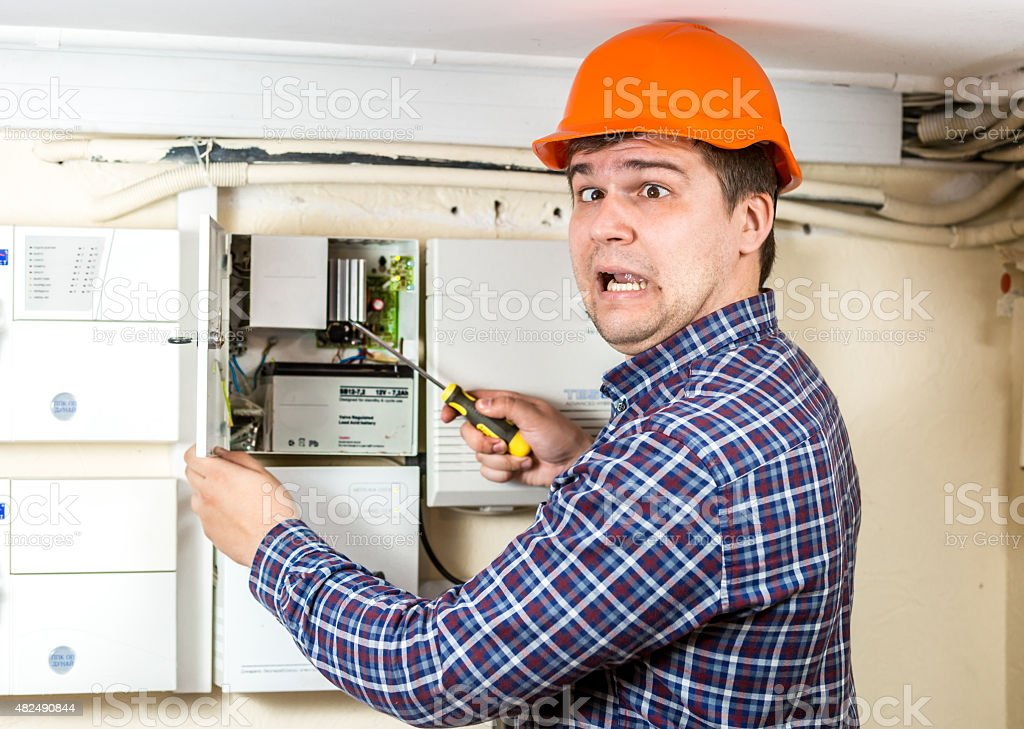 electrician got high voltage shock while repairing electrical sy stock photo