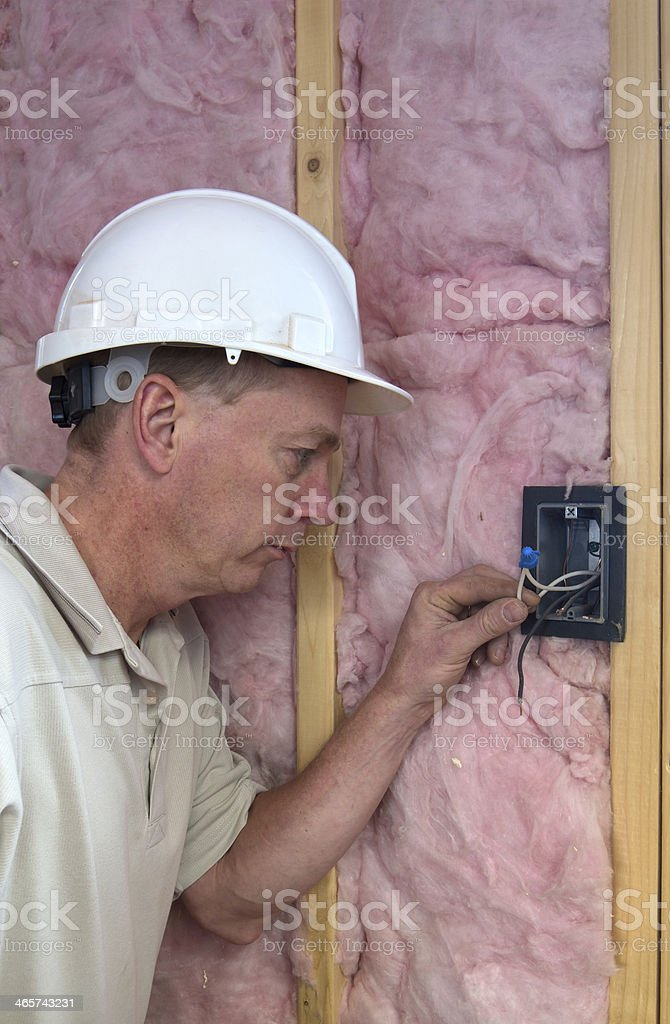 Electrician Inspecting Wiring stock photo