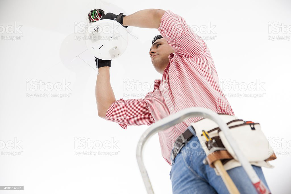 Electrician installing a lamp stock photo