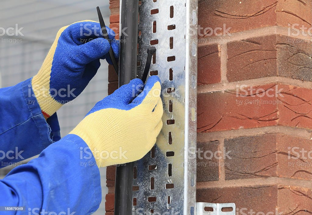 Electrician installing a power cable royalty-free stock photo