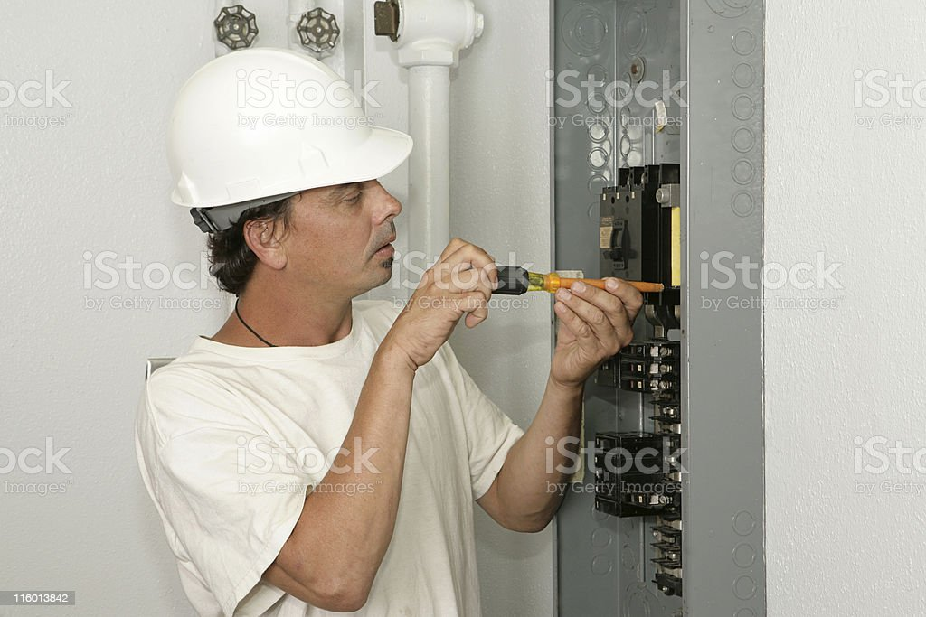 Electrician Installing Breaker royalty-free stock photo