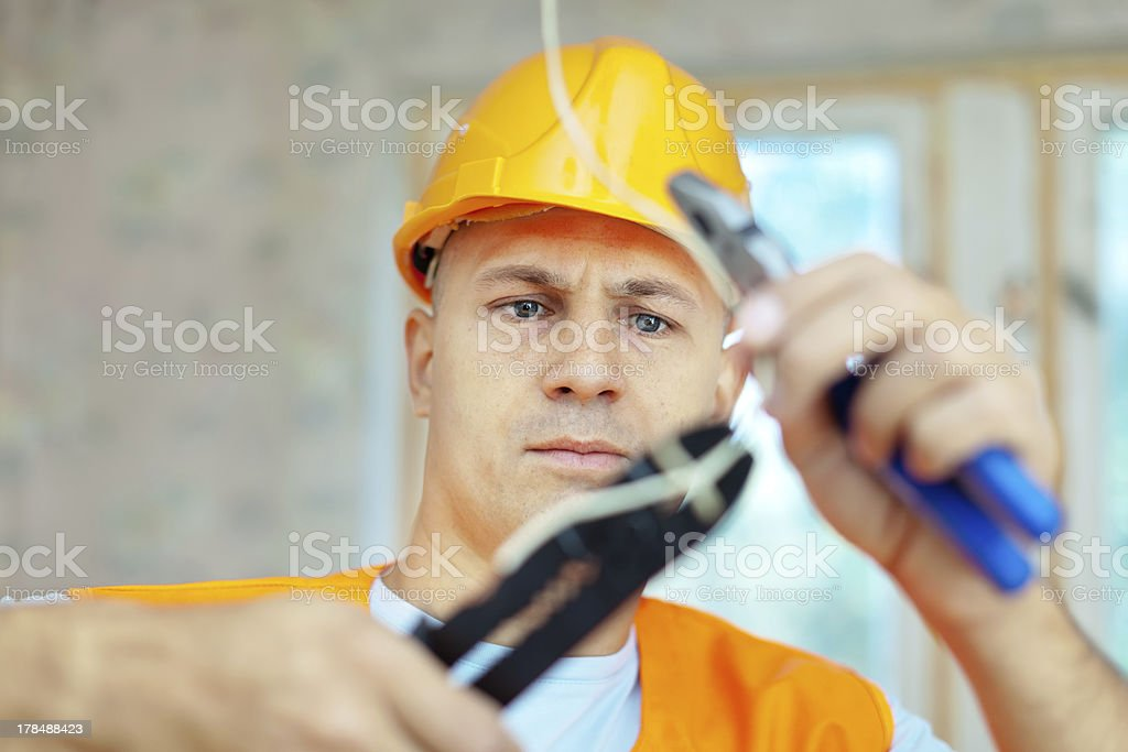 electrician installing electricity stock photo