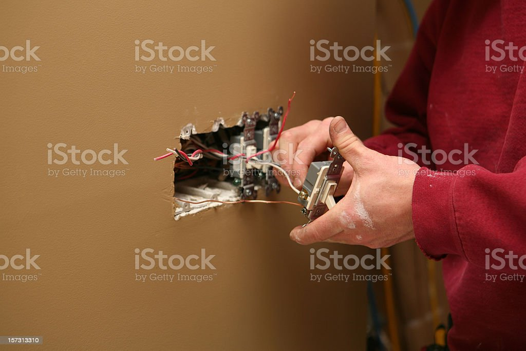 Electrician Installing Light Switch royalty-free stock photo